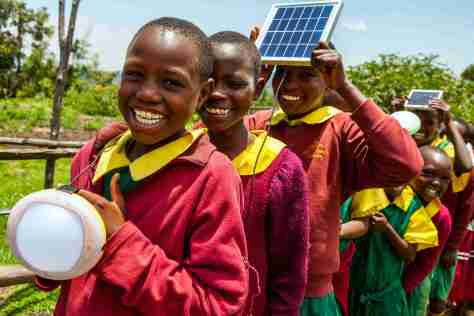 Solar powered lights bring smiles to the school children of Bomet County, Kenya. Corrie Wingate