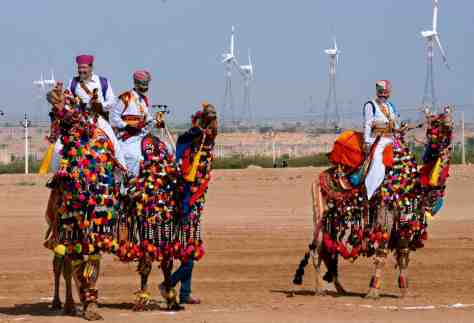 Camels and their riders in celebratory attire at the inauguration of a new wind farm in Khuri, Rajasthan, India. Sudipto Das